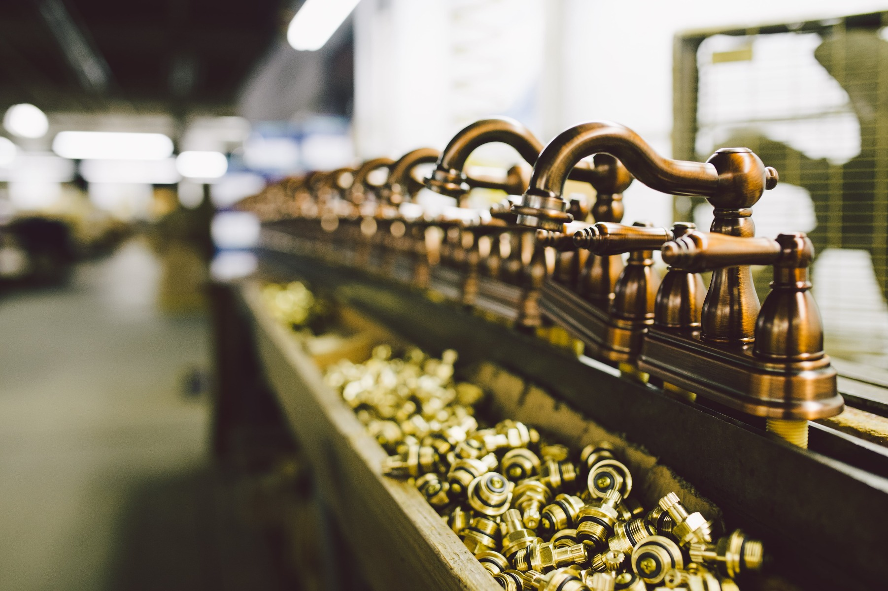 Faucets in production line at factory in Cleveland, Ohio